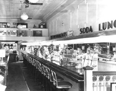 "The old warning ""No Shirt, No Shoes, No Service"" may not have applied at the soda fountain in this Jacksonville store.  A sign on the back wall reads, ""DO YOUR SHOES NEED REPAIR? WE FIX 'EM WHILE YOU WAIT."" The photo dates from 1947."